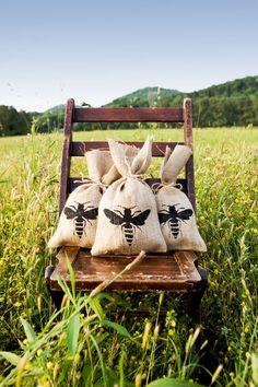 Burlap bee favor bags | Photography by Brooke Boling / brookeboling.com, Invitations by Lauren Ledbetter / laurenledbetter.com/
