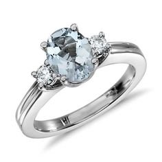 Aquamarine and Diamond Ring in 18k White Gold (8x6mm) | Blue Nile I love the idea of a colored gemstone as the central gem with diamond pairings :-)