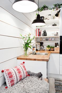 Kitchen idea: Open shelves, butcher block counters, and cozy bench