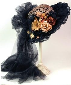 Stagecoach Bonnet      A vintage design is bestowed with crochet lace overlay on a prim wool felt classic. Black-eyed Susans and blooms in Indian Summer colors are nestled upon a lace-trimmed brim with extended illusion netted train. Arrives in a keepsake hatbox.