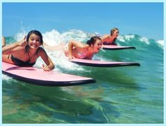 If I were in better shape I'd love to do this: Surf The Bay - Surf School