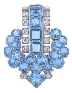 An Art Deco aquamarine and diamond clip by Cartier