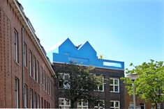 This rooftop house extension was the first project MVRDV realised in its hometown of Rotterdam. Situated on top of an existing historical building and at. Circular Economy, Small Buildings, House Extensions, Rotterdam, Pavilion, View Photos, Rooftop, Interior Architecture, Multi Story Building