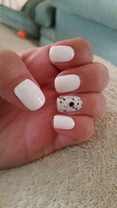 Gel polish. White with accent glitter nail. Black and White.