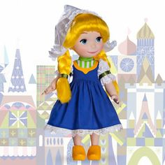 """It's A Small World Doll Collection (Goede dag) - """"This cute Dutch girl in finely detailed traditional folk costume also sings in her native language! Listen to her sing 'it's a small world'' in both Dutch and English. GOEDE DAG!"""""""