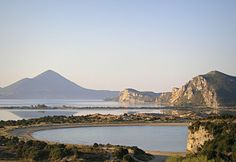 Gialova lagoon and Navarino Bay in the background. Beautiful Beaches, Places Ive Been, Grand Canyon, Greece, Around The Worlds, Mountains, Landscape, Travel, Spaces