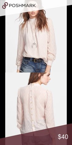 FREE PEOPLE after midnight blouse Champagne in color. Textured hashes form zigzagging stripes on this airy, sheer blouse. Finished with a trail of buttons doe the back placket. Buttons at cuff. New with tags. 100% polyester. Free People Tops Blouses