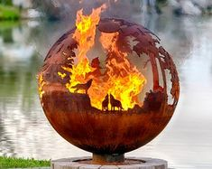 These fire pit ideas and designs will transform your backyard. Check out this list propane fire pit, gas fire pit, fire pit table and lowes fire pit of ways to update your outdoor fire pit ! Find 30 inspiring diy fire pit design ideas in this article. Fire Pit Sphere, Metal Fire Pit, Diy Fire Pit, Fire Pit Backyard, Fire Pits, Fire Pit Globe, Large Backyard, Fire Pit Gallery, Unique Garden