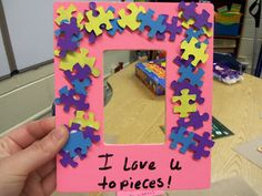 Paint puzzle pieces for a frame as a cute Mother's Day gift.