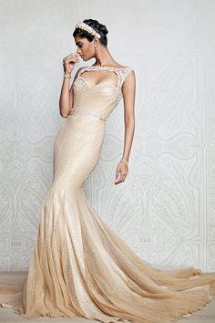 Indian fashion designer Tarun Tahiliani with a cutout wedding dress in cream and gems