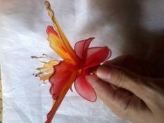 Make this lovely lily flower with nylon fabric. The more vibrant the color the more beautiful the flower will turn out. Try to find fabricthat comes in a gradient of colors. The different color tone will really bring out the beauty.  Here are the step by step how-tos:    Materials   nylon fabric floral wire foral stamen thread pen/pencil small bottle (i.e. nail polish) wire cutter