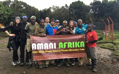 """This was taken at the last base camp after we summited Kilimanjaro. This is my crew of friends, along with our guides Jackson, Nas, and Paulo, and a few of our porters and cooks."""