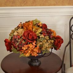 "Rose, Hydrangea Silk Floral Centerpiece AR325 - Beautiful arrangement of color for any room or season. Created with colorful hydrangeas, roses and peony. A perfect breakfast room size. A decorative metal vase adds further appeal. 16"" L x 14"" H"