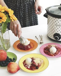 Don't put away your crockpot just because it's summer! This Slow-Cooker Peach and Blueberry Cobbler is a SIMPLE homemade dessert your dinner guests will love - and it won't make the house hot. Use whichever seasonal fresh fruit you like.