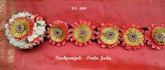 Poola Jada with orange rose petals, jasmine and golden ribbon applique.