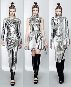 """Gareth Pughs S/S 2011 collection featured these garments drawing inspiration from """"space age,"""" and looking very similar to Paco Rabanne's unique style. Although Pugh used silver leather instead of metals and plastics Rabanne was known for using, the same look of space age and futurism is conveyed to audiences. The silhouettes follow different shapes, Pughs has a more defined waistline that Rabanne, but the female looks tough and invincible in her armor."""