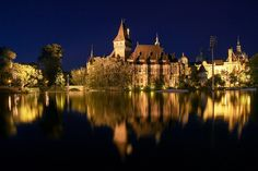 The Vajdahunyad castle in Budapest at night with the boating lake - Budapest, Hungary
