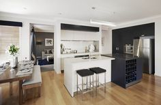 Kitchen - Soho, Metricon Australian. Like the wall with openings either end, keeps open plan but tucks kitchen away. Maximum storage in very little space.