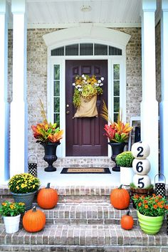 From the burlap sack door decoration to its use of symmetry, there's a lot we love about this pretty porch. But the fall-ready pumpkin topiary is the real eye-catcher.  See more at At The Picket Fence and get the tutorial.  MORE: 12 DIY House Number Displays That Will Instantly Up Your Curb Appeal   - CountryLiving.com