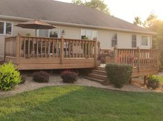 Split-level Deck with stairs set back but still forward-facing (good for a drive-way at front and decking at side)