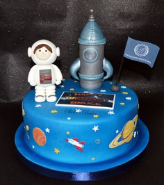Space themed birthday cake by Shelle's Bakes. Handmade sugar Rocket and Astronaut. Planets are edible images printed on icing sheets.