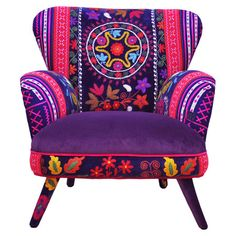 Add an eclectic style statement to your home with this handcrafted armchair, featuring vintage Suzani velvet and Thai Hmong mix upholstery. A one of a kind p...