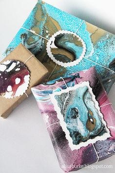 Marbleize anything (even wood, glass or plastic) with spray paint on water. This can become a work of art in itself!