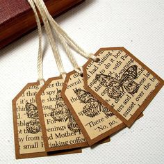 so simple but so cute - gift tags from book pages, stamped with butterfly