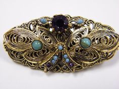 This is a stunning stick pin brooch out of the lovely consigned estate of jewelry that ranged in age from the 1920s - 1950s. This is a rolled