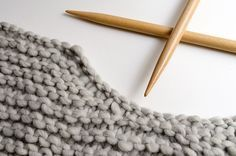 Now that you know how to join and seam knitted pieces when making your WAK sweaters and how to pick up stitches around the neck, we want to teach you a new technique to make your sweaters come out even better. Did you know that you can shape necklines without having to cast off stitches …
