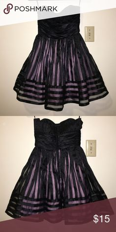 Betsy Johnson Short Prom Dress Black with lavender lining. Fitted in chest and then flares out. Soooo cute! Just trying to clear out closet, nothing wrong with it. Only worn twice. Betsey Johnson Dresses