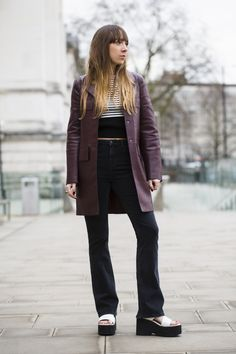 Give height to flares with platforms. #seventies #LFW #FashionWeek #streetstyle