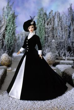 1997 Classique Collection Barbie® doll features a striking combination of black and white in a timeless silhouette. Created by designer Ann ...