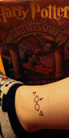 My Harry Potter Tattoo...Voila!    The first of many tattoos to come! The stars are the same ones lining each chapter title in the books, and of course, the infamous scar and round glasses...    After all, Harry was my Childhood.