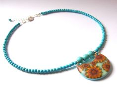 Polymer clay millefiori pendant and howlite beads by me.