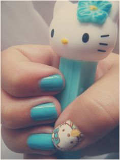 turquoise Hello Kitty nails