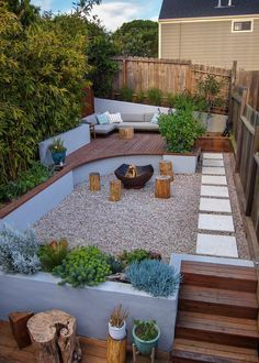 Landscaping Ideas - This modern landscaped backyard has a raised outdoor lounge deck, a wood burning firepit, succulents, bamboo, and a vegetable garden. #LandscapingIdeas #GardenIdeas #PlantIdeas #ModernYard #ModernBackyard #TieredYard Landscaping On A Hill, Cheap Landscaping Ideas, Small Backyard Landscaping, Pool Backyard, Desert Backyard, Patio Ideas, Arizona Backyard Ideas, Narrow Backyard Ideas, Backyard Landscape Design