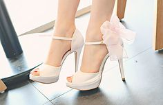 Cute white heels with a bow