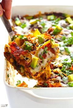 Easy Chicken Enchilada Casserole. GF, she also tells you how to make them vegan and dairy free.  gimmesomeoven.com #mexican #glutenfreel