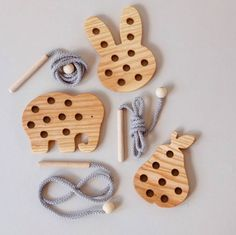 These ash wooden lacing toy are perfect for practicing fine motor skills and developing independence. Available in a variety of fun designs with a wooden threading needle, ball and cord. They make a lovely little toy, perfect for +CE tested. Wood Kids Toys, Wood Toys, Diy Wooden Toys For Toddlers, Making Wooden Toys, Wooden Animal Toys, Wooden Baby Toys, Wooden Elephant, Diy Toys, Wooden Diy