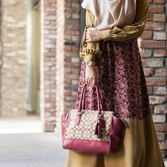 """""""Abeela Abaya - Famous for its casual look wear suits every occasion and season, inspired by pastel and also dark colors featuring bishop sleeves, side pockets as well as back-ribbon.It comes with 7 beautiful colours."""""""