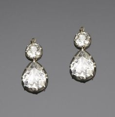 A pair of 19th century diamond pendent earrings  Each old brilliant-cut diamond surmount suspending a pear-shaped diamond drop, collet-set in silver and gold, diamonds approximately 4.80 carats total, length 2.6cm., later hook fittings, cased by Hancocks & Co, 9 Vigo Street, London, W1.