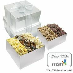 Filled with our trio of rich Butter Popcorn, sweet and savory Kettle Corn and our exclusive White & Dark Chocolate Swirl Caramel Corn, and topped with our jumbo Pistachios and Sprinkled Pretzels duo, these stylish gift boxes are the sweetest way to please everyone.
