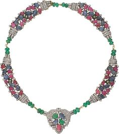 Desgined as a 'Tutti Frutti' multi-gem necklace, with carved sapphire, ruby and emerald leaves, to the collet-set circular-cut diamond accents and pavé-set diamond frame, mounted in 18K yellow gold, length 15 1/2 inches.