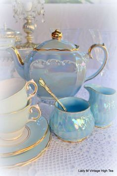 Love the shape of the sugar bowl and the iridescence of the tea set.