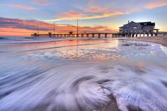 Sunrise beach scene at Jennette's Pier in Nags Head on the Outer Banks of North Carolina.