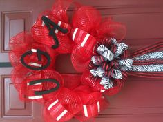 University of Georgia wreath!! ONLY 40$! Wow! I love mine that I got from Amy Kangiser. Check her out on Pinterest! Any collegiate team available. Many designs.