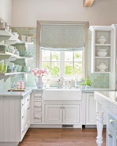 The prettiest #kitchen cleanup zone we've ever seen. Photo by #johngranen. #farmsink #mycountryhome