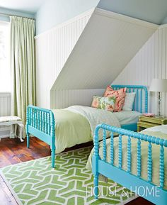 This playful guestroom mixes sky blue and coral with on-trend green textiles. | Photographer: Stacey Brandford | Designer: Kate Stuart, Natalie Hodgins