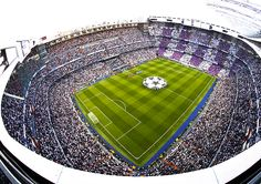 A general view before and during the UEFA Champions League Quarter Final second leg match between Real Madrid CF and Club Atletico de Madrid at Estadio Santiago Bernabeu on April 22, 2015 in Madrid, Spain